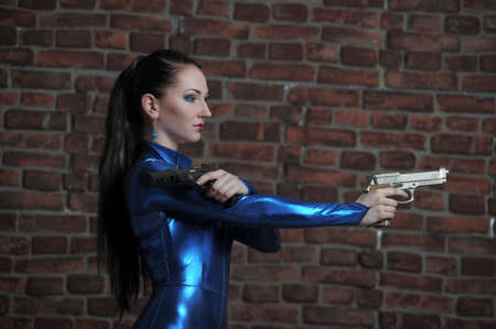 Martial young lady with gun  photo