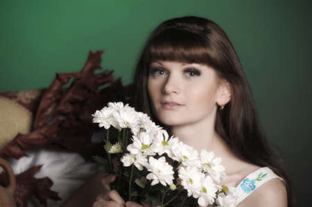 young woman with daisies Stock Photo - 12466056