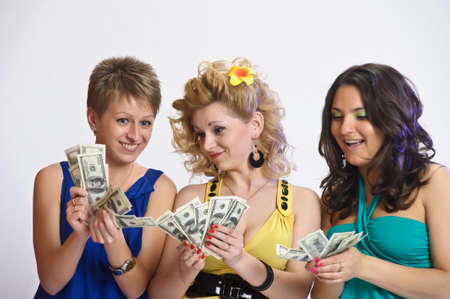 girls with money  in their hands photo