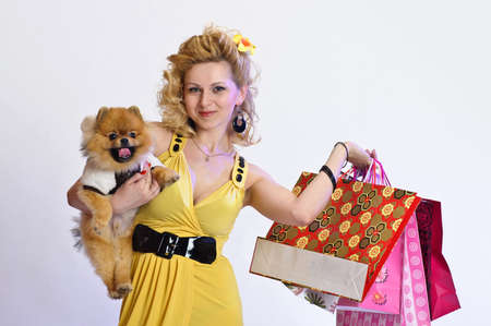 girl with shopping and a Dog photo