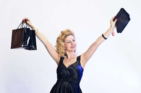happy young woman buying a new handbag photo