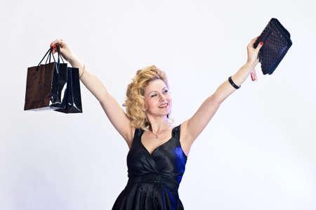 happy young woman buying a new handbag Stock Photo - 12587401