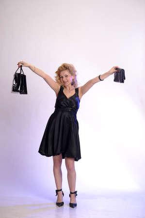 happy young woman buying a new handbag photo