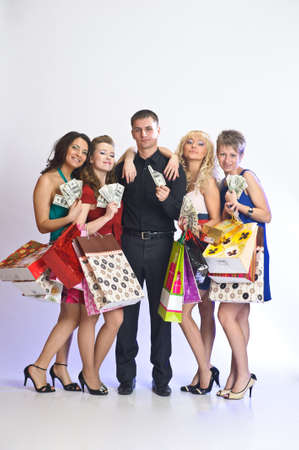 women with shopping bags take money from the man Stock Photo - 12587763