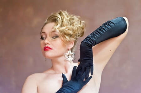 Retro blonde in black gloves Stock Photo - 18340512