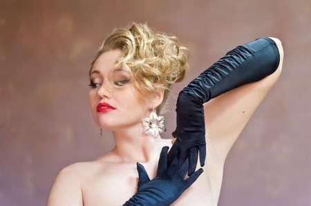 Retro blonde in black gloves Stock Photo - 18340512