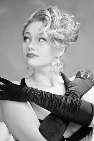 Retro blonde in black gloves photo