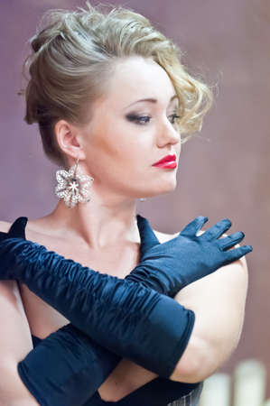Retro blonde in black gloves Stock Photo - 18340509