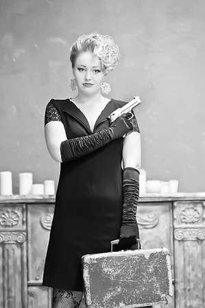 Blonde holding a gun photo