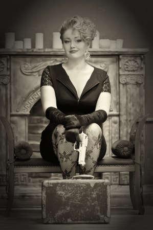 Blonde holding a gun Stock Photo - 13251492