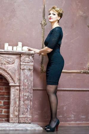 blonde in an elegant black dress photo