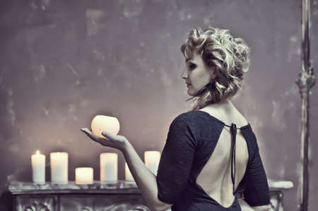 Studio picture of a young woman with candles Stock Photo - 15109642