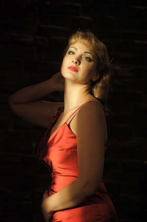 Beautiful pretty woman posing in red dress  photo