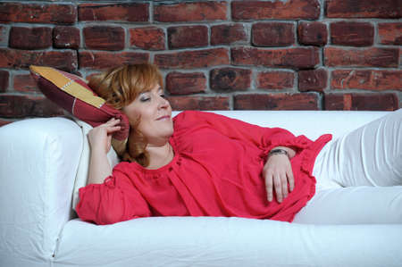 woman lying on the sofa relaxing Stock Photo - 17890847