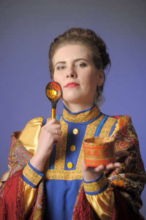 Woman in Russian folk clothes photo