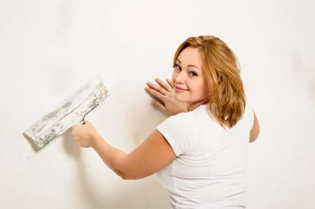 girl plastering the wall Stock Photo - 12464785