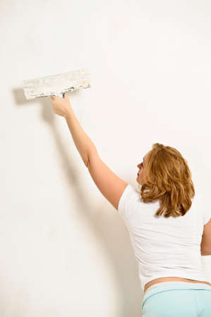 girl plastering the wall Stock Photo - 12464782