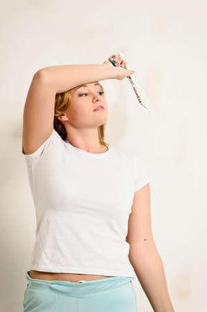 plastering: girl plastering the wall
