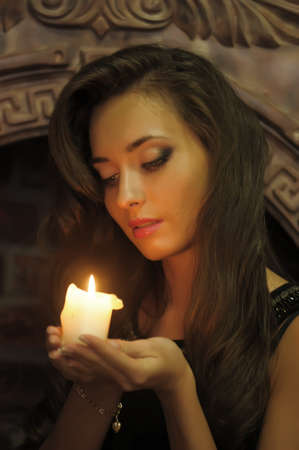 The brunette from candles in hands photo