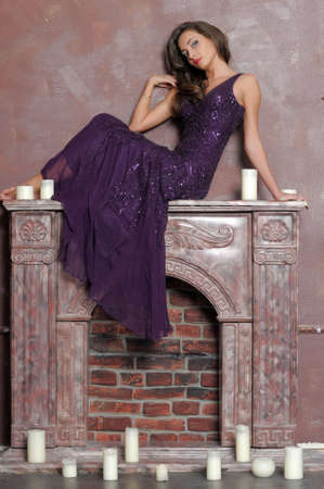 the girl sitting on a fireplace Stock Photo - 13280704