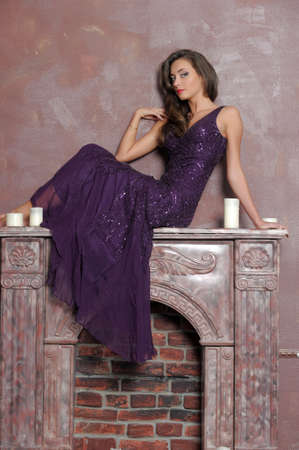gypsy woman: the girl sitting on a fireplace Stock Photo