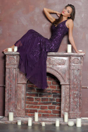 the girl sitting on a fireplace photo