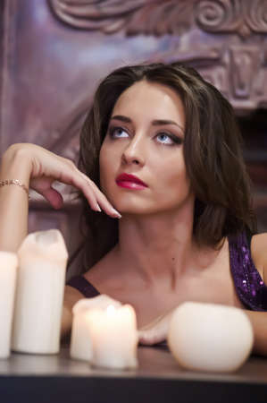 diviner: the beautiful brunette with candles