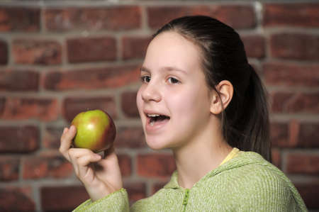 Teen eating green apple Stock Photo - 12464795