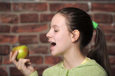 Teen eating green apple  Stock Photo - 12464796