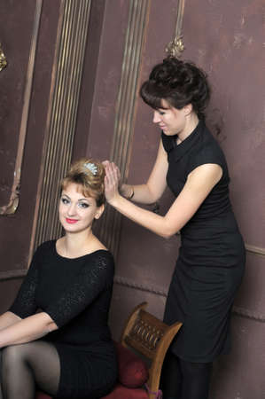 straightens her hair stylist to shoot model  photo