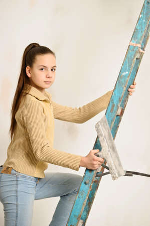 The girl is the house painter Stock Photo - 12676146