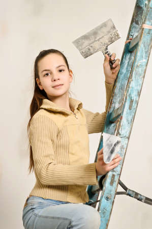 The girl is the house painter Stock Photo - 12676142