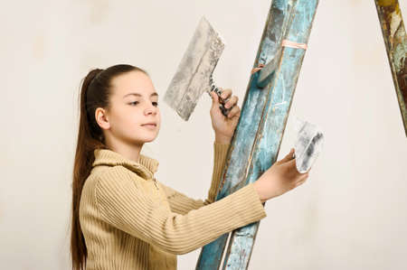 patching: The girl is the house painter  Stock Photo