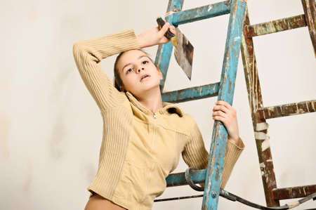 The girl is the house painter Stock Photo - 12676129