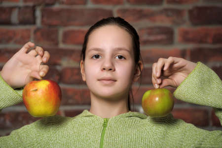 Teen girl with  apples photo