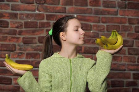 The girl the teenager with bananas photo