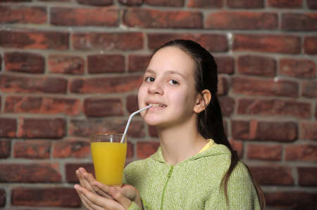 The girl the teenager with orange juice photo