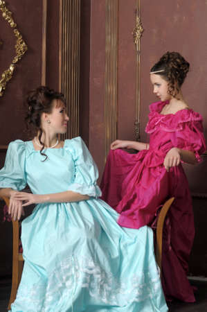 Two ladies in medieval dresses Stock Photo - 13280629