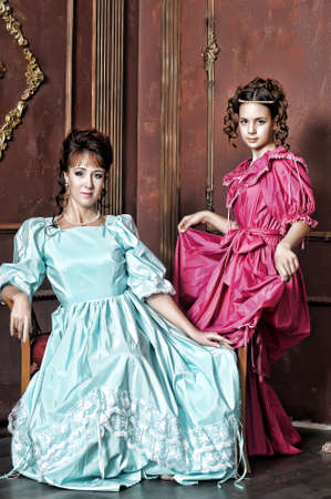 Two ladies in medieval dresses Stock Photo - 13280576