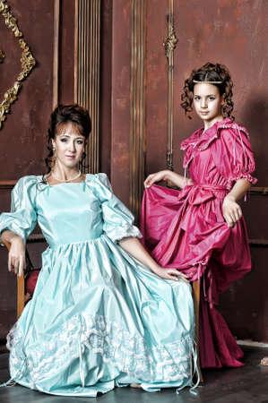 Two ladies in medieval dresses photo