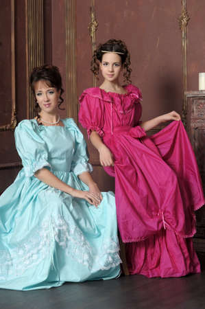 Two ladies in medieval dresses Stock Photo - 13280574