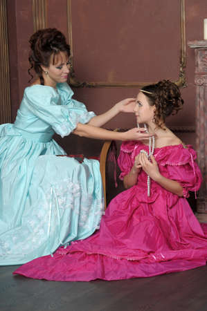 Two ladies in medieval dresses Stock Photo - 13280570