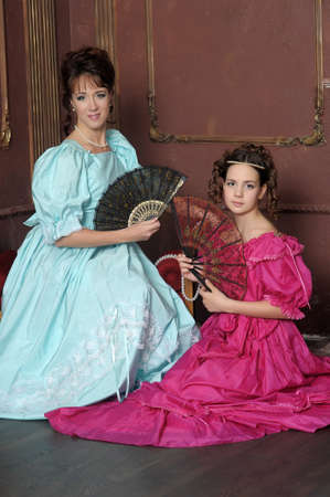 Two ladies in medieval dresses Stock Photo - 13280579