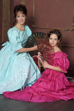 Two ladies in medieval dresses Stock Photo - 13280578