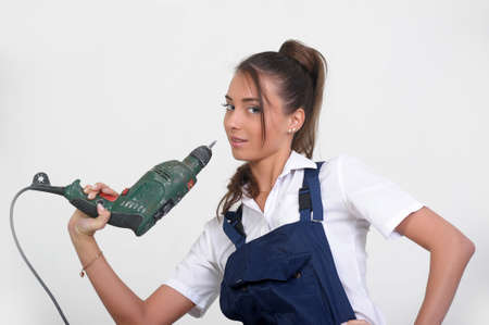 Closeup of a beauty girl with drill machine on white background Stock Photo - 13280623