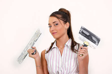 redesign: Girl plastering the wall  Stock Photo