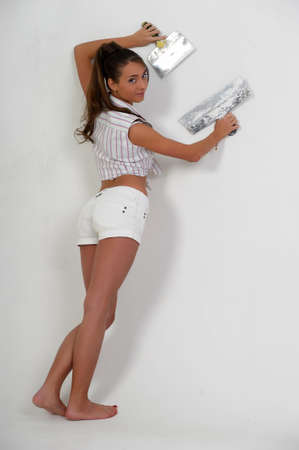 Chica enyesar la pared photo