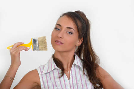 Image of a beautiful girl on white, holding paint brush Stock Photo - 12676086