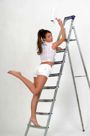 The girl is the house painter Stock Photo - 12676083