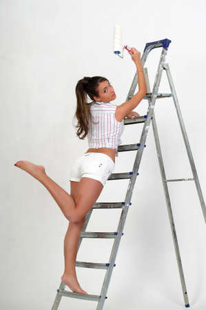 painting and decorating: The girl is the house painter  Stock Photo